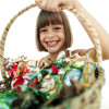Young Girl Holding Up a Basketful of Candy