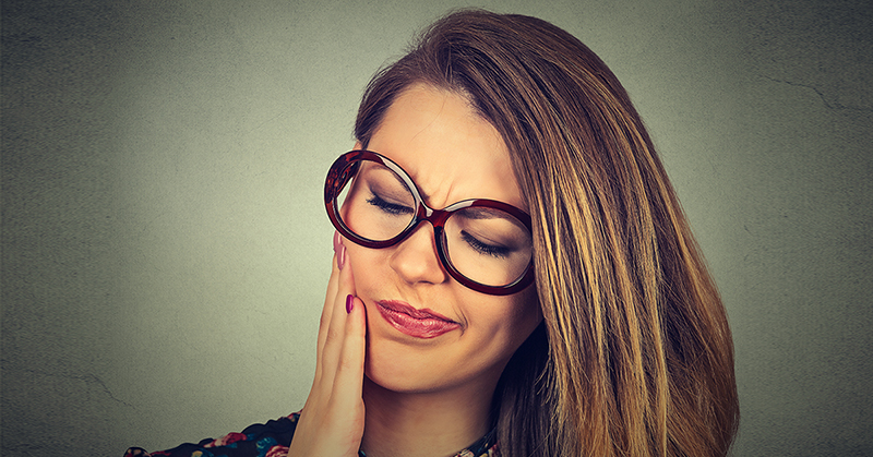 Woman in Pain From an Infected Wisdom Tooth